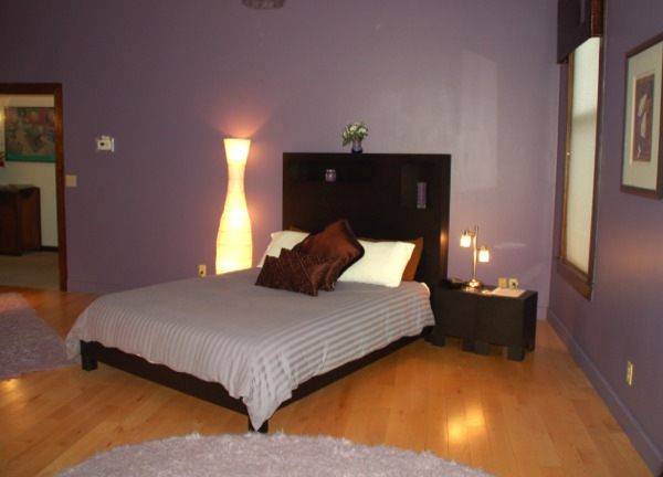 bedroom set a futon sleeper plum colored walls and a new wood floor